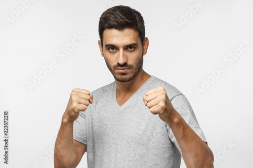 Confident sporty boxing man holding fists in front of him, going to fight and de Tablou Canvas