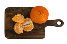Mandarin - Whole Fruit And Cantles On Wooden Board. Top View. Isolated On White.