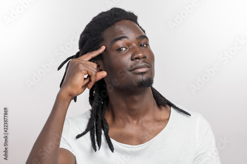 Fotografie, Obraz  portrait young executive african man gesturing with finger against temple
