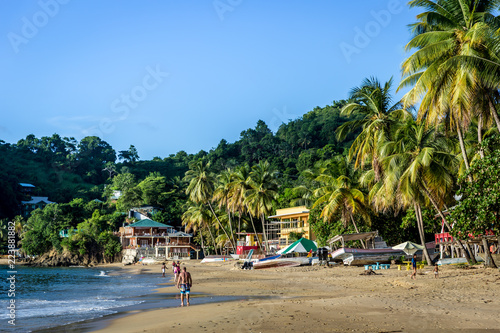 Cadres-photo bureau Barcelona Few tourists enjoying a amazing tropical beach in the late sunset. Trinidad and Tobago, Caribe