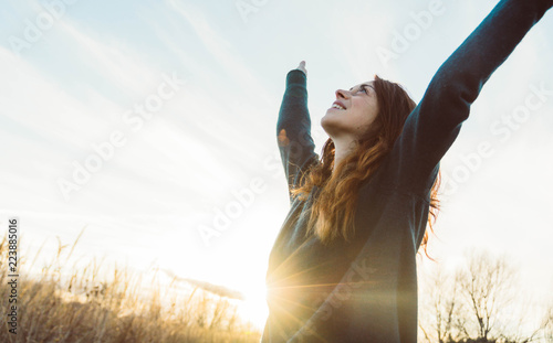 Obraz Young woman relaxing in summer sunset sky outdoor. People freedom style. - fototapety do salonu
