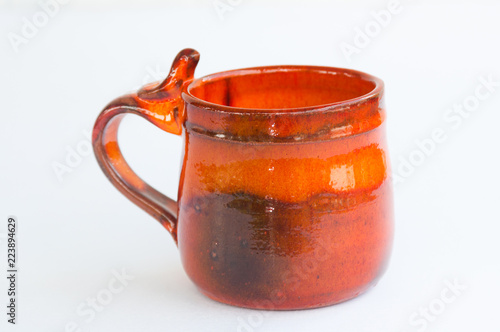 Orange pottery mug
