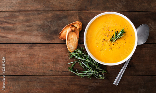 Valokuvatapetti Pumpkin and carrot  Cream soup on rustic wooden table