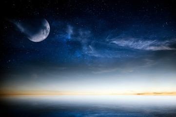 Calm sea sunset over night sky with stars and moon. Moon on this image furnished by NASA