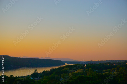 Fotografie, Tablou  Poughkeepsie, New York: View of sunset over the Hudson River, with the Catskill Mountains in the background, from the Walkway Over the Hudson