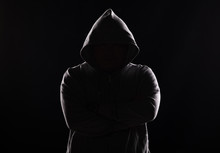 Studio Portrait Of A Guy In A Hood On A Black Background