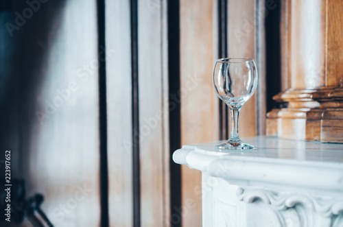 Empty wine glass in a beautiful interior