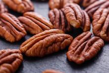 Delicious Pecan Nuts On A Dark...