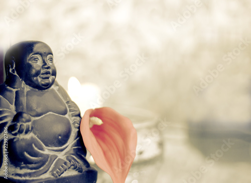 Tuinposter Boeddha Generic buddha decoration with candle and flower