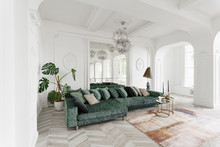 Morning In Luxurious Light Interior In The Baroque Style. Bright And Clean Interior Design Of A Luxury Living Room With Parquet Wood Floors, Fireplace, Sofa And Houseplant. Stucco On Walls