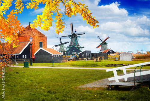 traditional Dutch rural scene with windmills of Zaanse Schans, Netherlands at fa Canvas Print