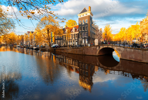 Aluminium Prints Autumn Dutch city scenery with canal and mirror reflections, Amstardam, Netherlands at fall