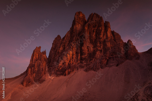 Awesome enrosadira effect at sunset on Dolomite mountain, South Tyrol, Italy