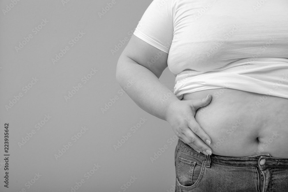 Fotografia, Obraz  Overweight woman on color background