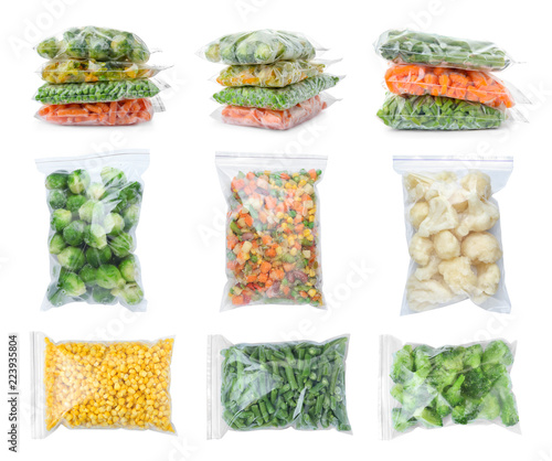 Set with frozen vegetables in plastic bags on white background