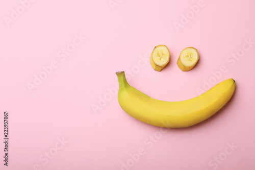 Poster Fruit Funny flat lay composition with bananas on color background. Space for text
