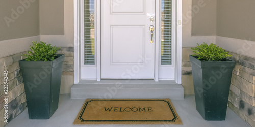 Photo Front door with doormat plants and glass panel