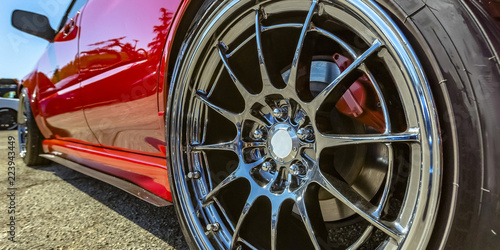 Polished rim of a bright red car Fotobehang