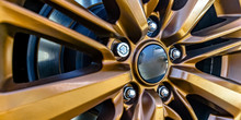 Rim Of A Car Wheel With Golden Spokes