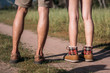 Legs of couple hiking walking outdoor in nature forest