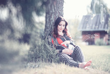 Pregnant Girl In A Dress In Nature