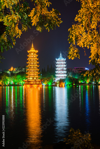 Fotobehang Guilin Night view of the Sun and Moon Pagodas at Shanhu Lake or Fir Lake. Gold and Silver Pagodas locate at downtown of Guilin, China. Guilin is a popular tourist destination of Asia.