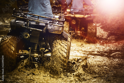 Photo Stands Motor sports man riding atv vehicle on off road track