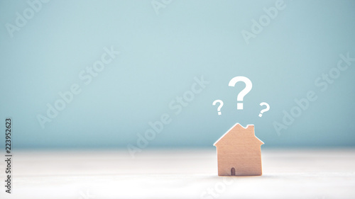 Wood House Model with question marks over the wooden desk and free copy space for your text Canvas Print
