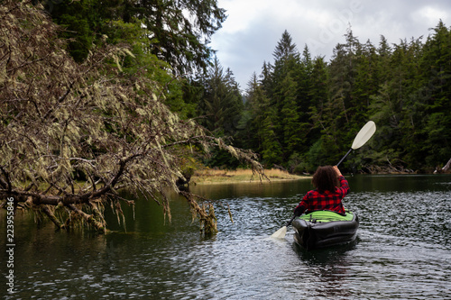 57c2aaf474c1 Girl kayaking in a river during a cloudy summer day. Taken in Cape Scott  Provincial Park