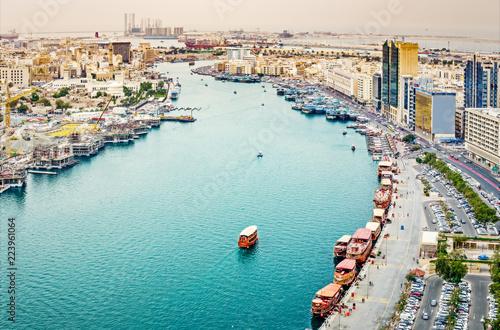 Fotobehang Midden Oosten Aerial daytime skyline of Dubai, UAE. View on harbor in the distance. Scenic travel background.