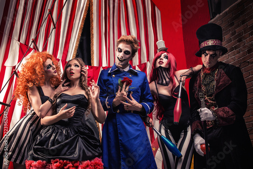 Fotografie, Obraz Circus troupe from freak show staying on stage of daark circus