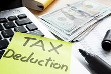 Tax Deduction Written On A Memo Stick.
