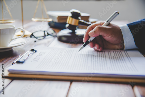 Vászonkép  Law theme, mallet of the judge, law enforcement officers, evidence-based cases, and documents taken into account
