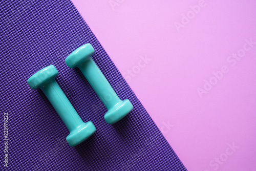 Obraz dumbbell and yoga mat on table, fitness healthy and sport concept - fototapety do salonu