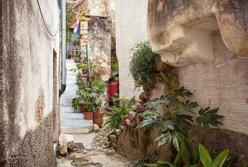 Fototapeta Narrow street with stones houses in Croatia, Vrbnik on Krk Island