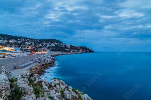 Fotobehang Nice Travel France, holidays, vacation. Nice, Cote d'Azur. Summer evening, blue hour, sea shore (long exposure), mountains on the background