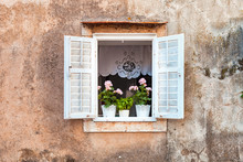 Traditional Old Window With Flowers In Stone House, Mediterranean Style