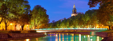 The Night Panoramic View Of Aura River In Turku, Finland With A Clock Tower Of Cathedral And Bridge On A Background.