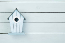Blue Wooden Bird House On A Bl...