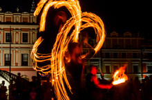 Fire Show On The City Square At Night, Artists Juggle With Fire, Long Exposure