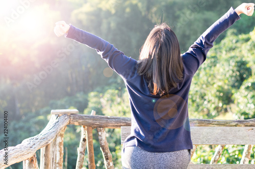 Obraz Country home with wellbeing relaxed nice hair woman feeling good during vacation in natural resort interior. Happiness Happens Day - fototapety do salonu