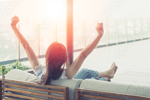 Canvas Prints Relaxation Easy relax business woman lifestyle after work at hotel sitting hands behind head for happy businesswomen people. Simplify Your Life Week. International happiness day.