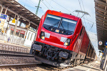 German Freight Train Passes A Train Station