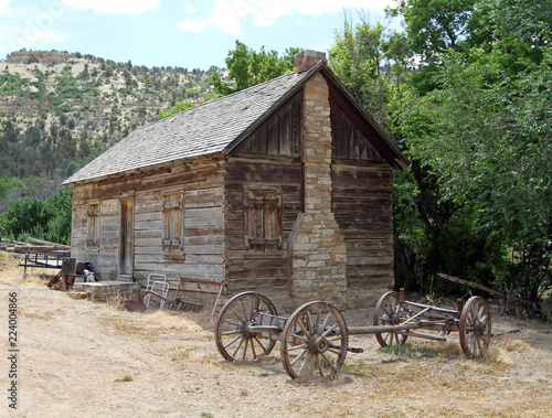 Fotografie, Obraz  old rustic cabin with stone chimney and wagaon frame, southwest Utah, USA