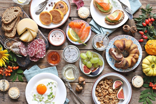 Thanksgiving Brunch. Autumn family breakfast or brunch set served on rustic wooden table. Overhead view, copy space