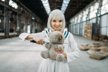 Anime Style Lady Cuts Off The Head Of A Teddy Bear