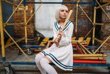 Anime Girl With Baseball Bat, Doll In Uniform