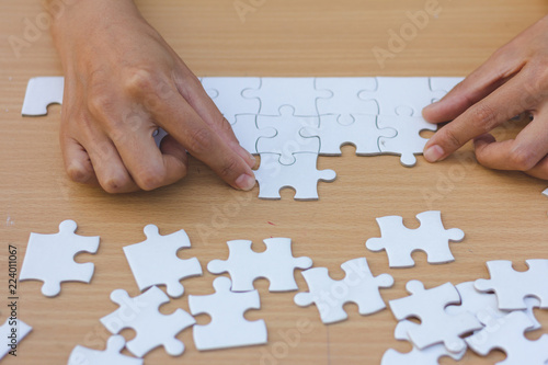 Fototapety, obrazy: Close up of hands business women connecting jigsaw puzzleon, Teamwork workplace success and strategy concept.