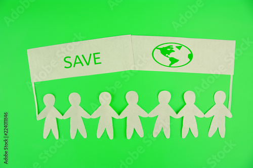 Valokuva  ecology concept. paper people holding banners save the planet
