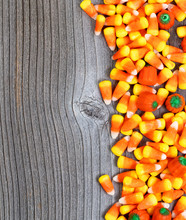 Halloween Trick Or Treat Candy With On Rustic Wooden Boards